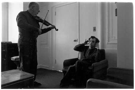 Dad playing violin to Mike