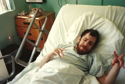 autistic brother mike in hospital bed with hand gestures