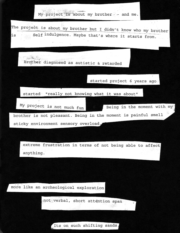 strips of paper with writing pasted on black background