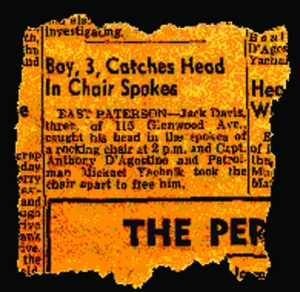 newspaper clipping of Jack with head stuck in chair