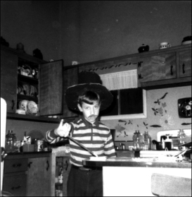 Little Brother in kitchen with magic wand