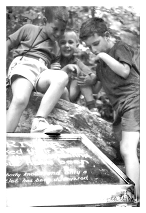 Mike, Jack and Little Brother at Lost River on rock on top of a plaque