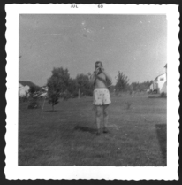 Dad with camera, in the yard