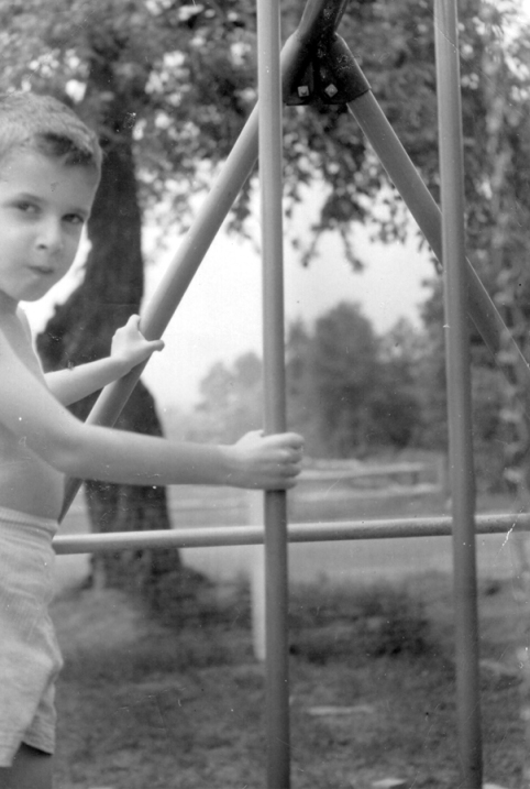 Mike in yard on a swing set