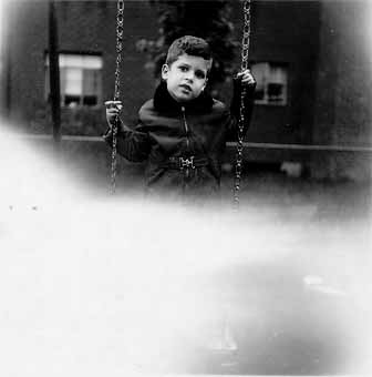 Mike on swing at about 5 years of age