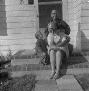 Li'l bro, Dad and Mom with pumpkin instead of a head