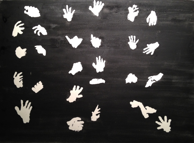 reverse silhouettes of hands, revealed after latex masking removed