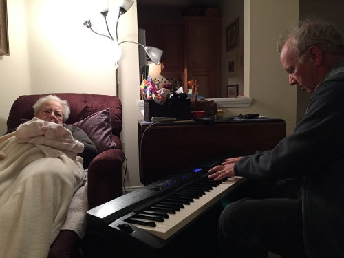 Photograph: Dave Playing Happy Birthday to Mom on her 90th Birthday