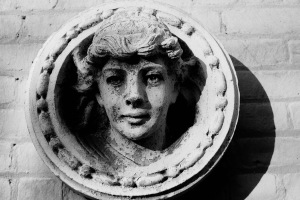 Photograph: Sculpture of Head on Wall at Brooklyn Museum