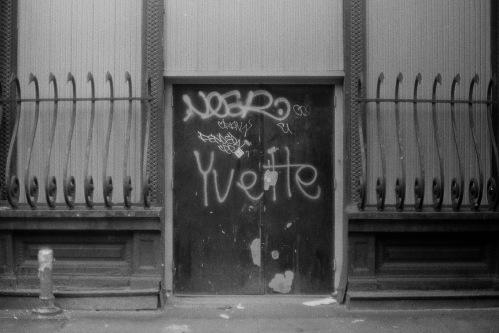 Photograph: Graffiti on Door of Elegant Storefront