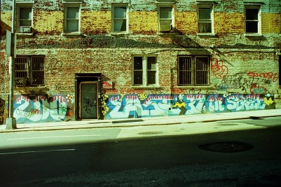 Photograph: Street Scene - Building with Graffiti in the Morning