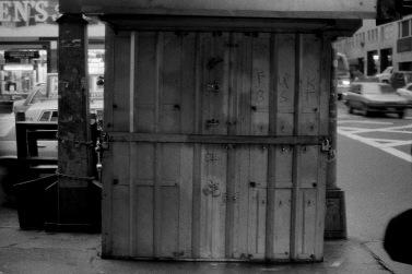 Photograph: Newsstand with Minimalist Graffiti