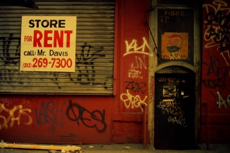 Photograph: Storefront for Rent with Graffiti