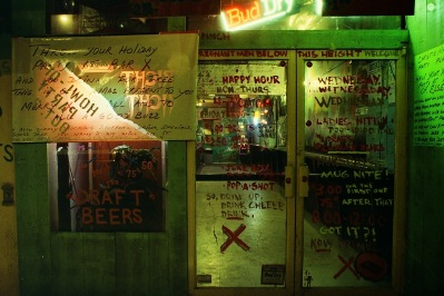 Photograph: Graffiti on the Doors to Bar X