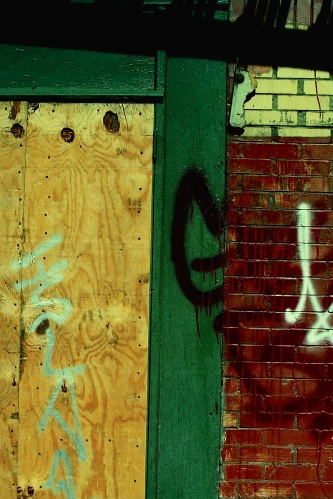 Photograph: Section of Boarded Up Window and Brick Wall