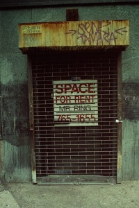 Photograph: Gated Storefront Space for Rent with Graffiti