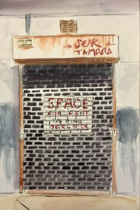 Watercolor: Gated Storefront Space for Rent with Graffiti