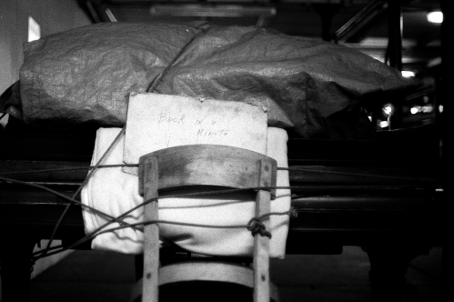 Photograph: Night Shot of Chair Tied to Piano Bench