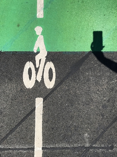 Photograph: Bicycle Icon on Street with Camera Shadow 070917