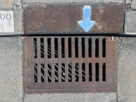 Photograph: Sewer and Blue Arrow 070117