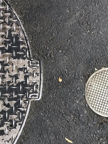 Photograph: Partial Mini Manhole Covers 081617