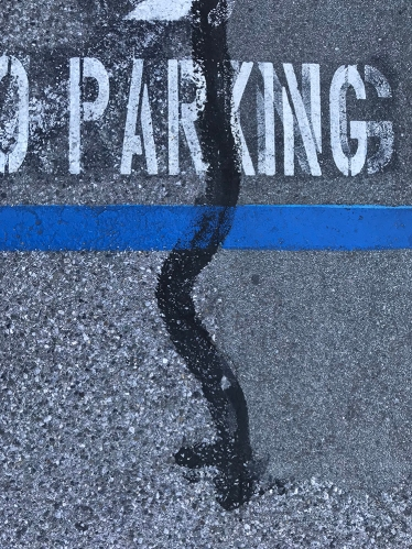 Photograph: Street Photography - Parking and Black Streak