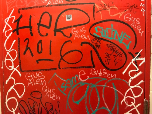 Photography: Street Photography - Graffiti on Red Door on Inside of Small Gas Station Bathroom
