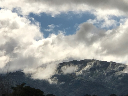 Photography: Sky Photography - Diminishing Blue Sky with Clouds and Mountain Top