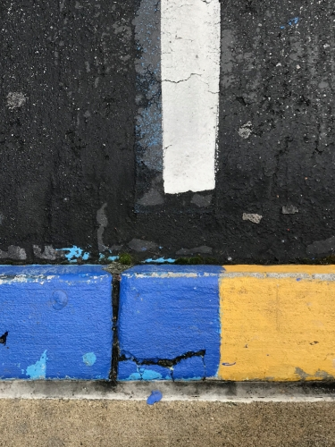 Photography: Street Photography - Blue Curb Running Over the Line into Yellow