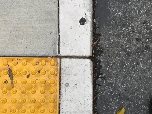 Photography: Street Photography - Geometric Pattern with Yellow Bumps and Leaves