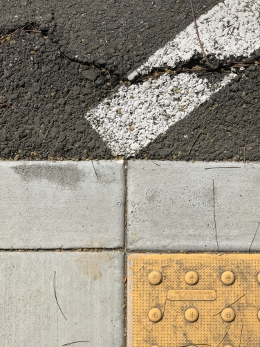 Photography: Street Photography - Old White Line at Fulcrum and Slanty Curb Viewed From the Top
