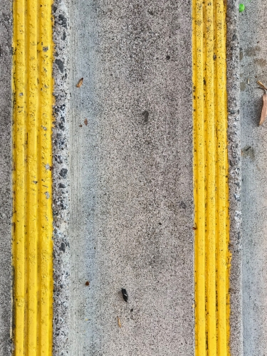 Photography: Street Photography - Parallel Yellow Lines in Parallel Flatland Universes
