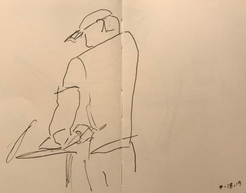 Pen and Ink Sketch -Large Man Standing and Reading