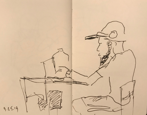 Sketch: Pen and Ink - Bearded Man with Headphones at Rest on His Ball Cap