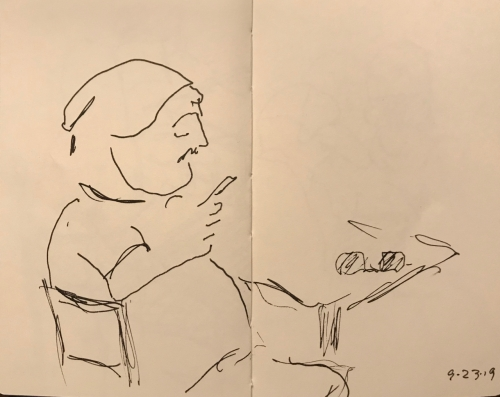 Sketch: Pen and Ink - Man with Neat Cap Resting Eyes on Phone, Sun Glasses on the Table