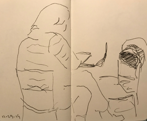 Sketch: Pen and Ink - Figure Studying Open Pocketbook