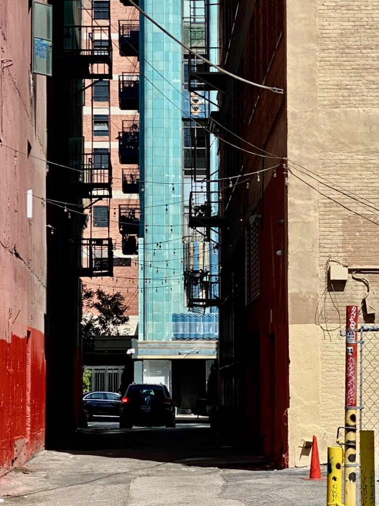 Street Photography: Blue Building Seen Through the Ally