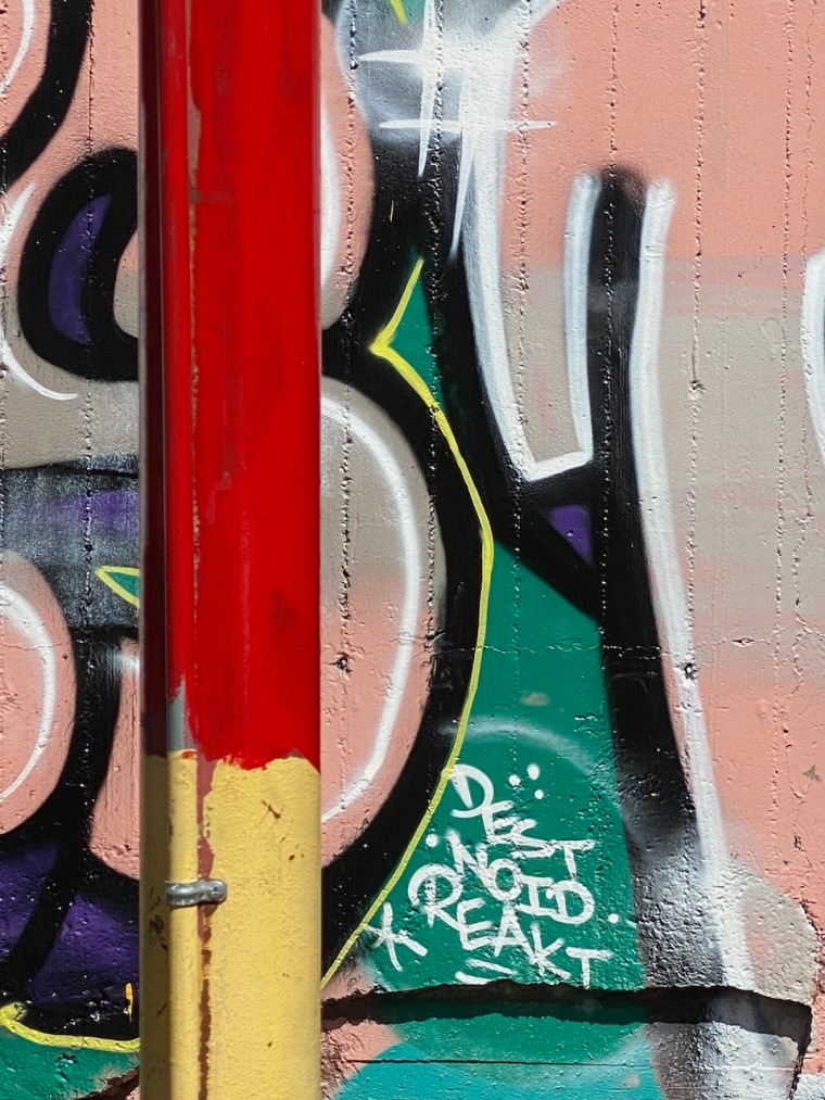Street Photography: Graffiti Close Up with Colorful Pole