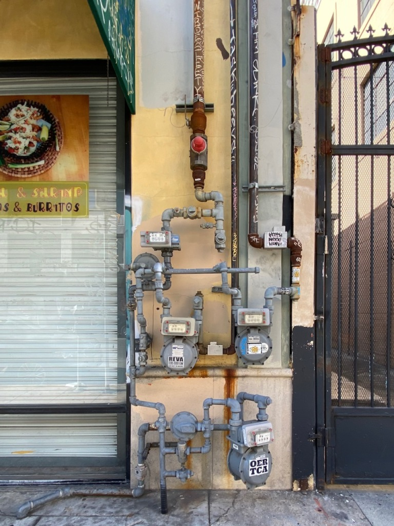 Street Photography: Meter-ology and Pipe Graffiti
