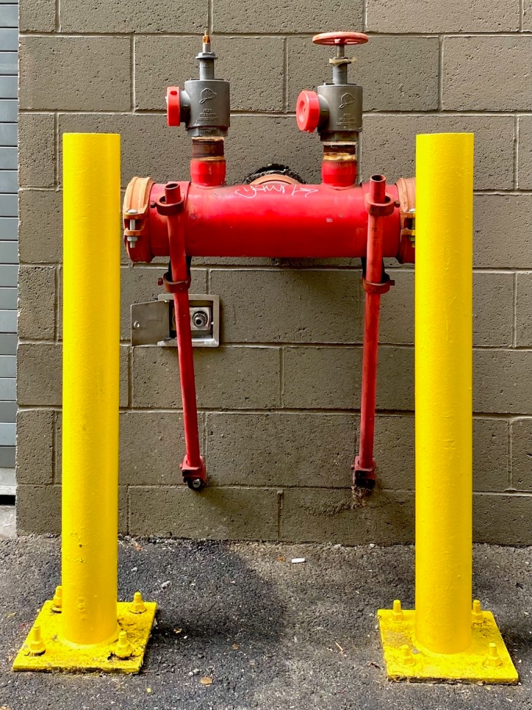 Street Photography: Yellow Poles Protecting Standpipe