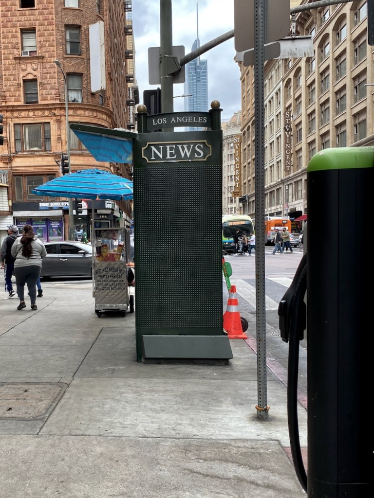 Street Photography: LA Newsstand with Electric Parking Spot