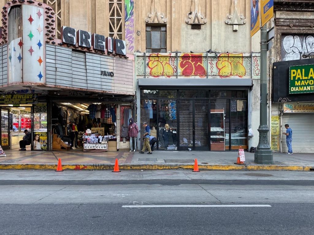 Street Photography: Graffiti Next Door to Movie Marquee