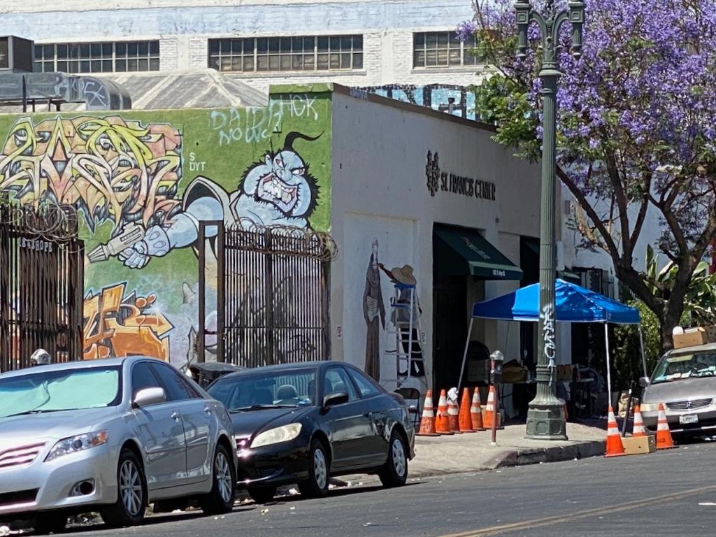 Street Photography: Graffiti versus St. Francis Center Painter