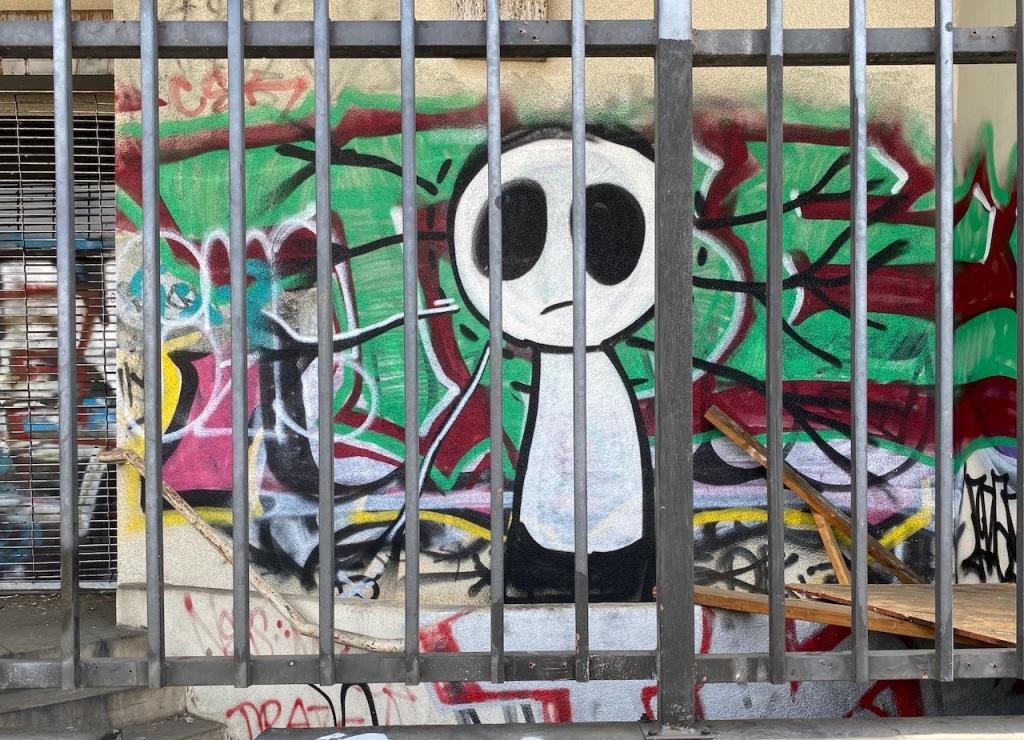 Street Photography: Ghost Graffiti Behind Bars