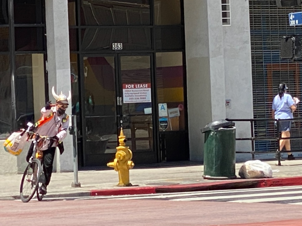 Street Photography: Horned Helmet Man in Traffic