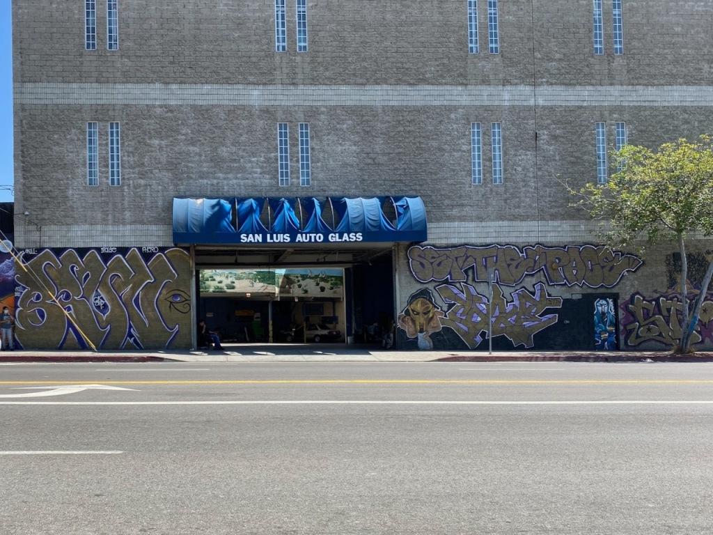 Street Photography: Mural inside Graffitied Building