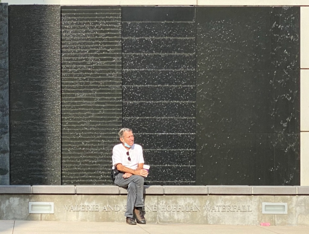 Street Photography: Waiting by the Waterfall
